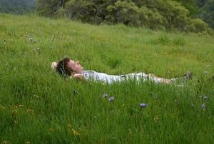 Easy land man lying in green grass