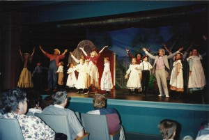 Cast (L to R) Alethis Hague Schoor, Tim Ruggles, Judy Armstrong (as Granny), Tink Robinson (as Underarm Tom) Andre Hickin, Kevin Redford (behind, with long arms up in the air) with the children